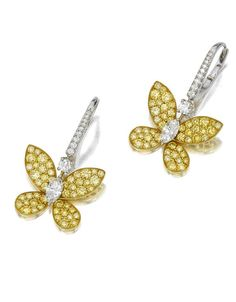 A pair of colored diamond and diamond pendant earrings, Graff each designed as a pavé-set yellow diamond butterfly, centering a marquise-cut diamond, from a circular-cut diamond surmount; signed Graff, no. GE13315; estimated total diamond weight: 3.05 carats; mounted in eighteen karat yellow and white gold.