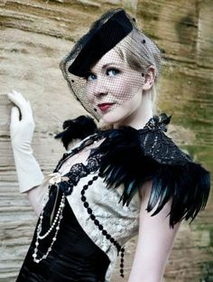 Black Narcissus feather epaulettes by Lovechild Boudoir.