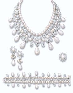 A UNIQUE AND MAGNIFICENT NATURAL PEARL AND DIAMOND PARURE, BY HARRY WINSTON  The necklace designed as a graduated fringe of eleven natural pearl drops weighing from 122.84 grains (30.71 carats) to 33.00 grains (8.25 carats) suspended from an elaborate, articulated necklace comprising one row of brilliant-cut and pear-shaped diamonds, one row of paired natural pearl drops, one row of brilliant and marquise-cut diamonds to the single-row of fifty-seven natural pearls, bracelet, ear pendants…