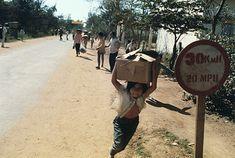 February Da Nang, South Vietnam --- Vietnamese Refugees Fleeing --- Image by © Bettmann/CORBIS Photo by Dana Stone South Vietnam, Da Nang, Riding Helmets, February, War, Google Search, Vietnam War