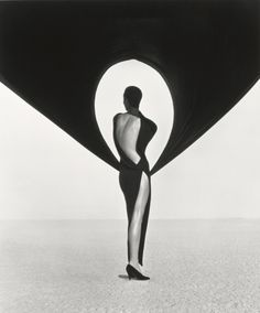 Herb Ritts—© Herb Ritts Foundation  Versace Dress, Back View, El Mirage, 1990