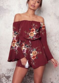 c3ac0659f6c9 Floral printed bell sleeve romper with an elasticated off-shoulder neckline.  Adjustable drawstring waistband
