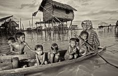 Badjao people live in simple houses on stilts in the middle of the shallow sea, often close to tiny islands off the coast of Borneo