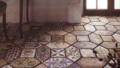 Some tile designs are so beautiful, they must be on 'display', and what's a better display than the flooring surface. Creating a tile centerpiece on your r