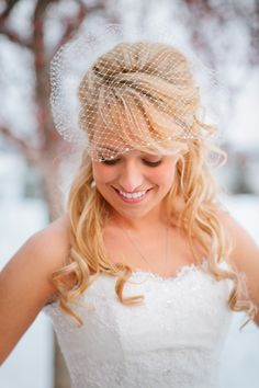 Stunning bride, beautiful veil, amazing snowy weather. The perfect Minnesota winter wedding day! #eileenkphoto