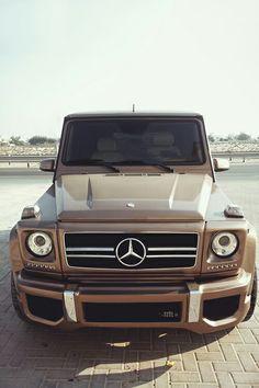 Luxe luxury living: Gold metallic paint Merc 4WD car vehicle
