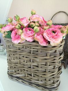 the bright pink bloom against the weathered basket ... perfection