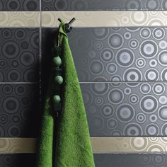 Aureole Tiles - Stunning ceramic Aureole Tiles from Envy. There is a choice between wall or floor tiles to really make your bathroom stand out. You can choose between three different colours, grey, cream or black. In this range the circular pattern can be use as a centre peace of your wall or even as a border.