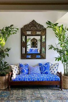 I love the vibrant blue of the pillows and cushions-mm...joy of nesting: Combining the Newlywed Household...Tips for Mixing, Matching and Compromising