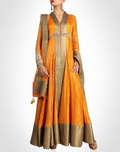 This orange hued anarkali is richly embellished by overall sequin and gota panels.SHOP NOW@ www.kimaya.in