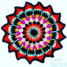 Sultan Sunburst Crochet Mandala | Free Crochet Pattern - Make this bright and bold crochet Mandala using treble crochet (US dc), spike and puff stitches with a picot edging for this week's free Monday Mandala crochet pattern.
