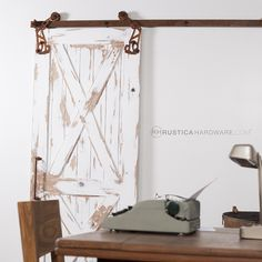Rusted Archer Barn Door Rollers & Track by Rustica Hardware
