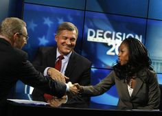 Rich Piatt shakes hands with 4th Congressional District candidates Rep. Jim Matheson and Saratoga Springs Mayor Mia Love after their debate on KSL 5 News in Salt Lake City on Thursday, Sept. 27, 2012.   (Laura Seitz, Deseret News)