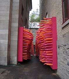 Hundreds of pool noodles invade an abandoned alley in Québec City, Canada, for the Delirious Frites installation created by creative collective Les Astronautes. fun interactive street art installation for summer fun when the kids are bored Interactive Installation, Interactive Art, Street Installation, Installation Architecture, Landscape Architecture, Graffiti, Street Art, Instalation Art, Urbane Kunst