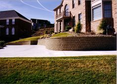 Pittsburgh retaining walls installation by PGHSW uses retaining wall block like Omni Stone and Versa-lok for it's retaining wall construction. Retaining Wall Construction, Privacy Walls, Wall Installation, Pittsburgh Pa, Landscape Design, Outdoor Living, Landscaping, Curvy, Patio