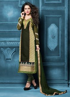 Look sensationally awesome in this green cotton   churidar salwar kameez. This ravishing attire is amazingly embroidered with embroidered, lace and resham work. Comes with matching bottom and dupatta....