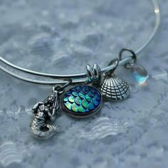 Just made! Mermaid bangle bracelet  with mermaid scales charm. The mermaid scales charm shows off so many colors when you move. It fun and flashy and who doesn't l9ve mermaid scales?  ;) This is the perfect gift for the whimsy hearted or the beach lover!