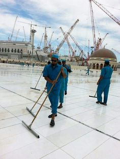 The cleaning crew busy  cleaning   outside  masjid al Haram.