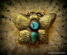 "Fair Trade Brass Floral Repousse Double Turquoise Cabochon Art Nouveau Style Nepalese Artisan Made Large Bale Focal Bead Top Width: 4""  wing tip to wing tip Bottom Width: 2 7/8""  wing tip to wing tip Length: 2 3/8""  Depth: 7/8"" front to back not including bale Bale Depth: 1/4"" at widest point, 1/2"" long  Weight: 2.453 oz  by TemplesTreasureTrove, $149.95"