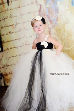 Beautiful ivory and black flower girl dress for wedding.