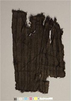 Pleated wool fragment from Gamla Lödöse, Västergötland, Sweden. Dated 1250 - 1349 CE, at the Statens historiska museum, via the Kringla database.