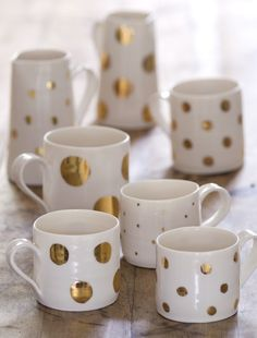 DIY Gold Sharpie Mugs -  Simply draw on your design with an oil-based Sharpie marker, bake in the oven for half an hour and allow to cool.