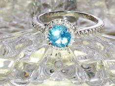 Swiss Blue Topaz Halo Ring or Engagement Ring by NorthCoastCottage Jewelry Design & Vintage Treasures on Etsy.com, $299.00
