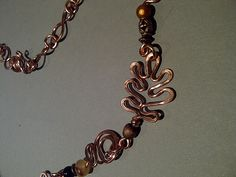 Copper hammered leaves necklace close up