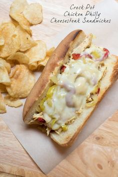 A delicious mixture of tender, shredded chicken, peppers and onions piled on hoagie rolls with melted cheese. ~ http://www.fromvalerieskitchen.com