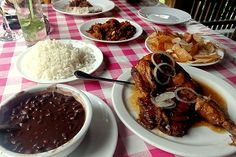 this would be a rich meal in Cuba. there is a lot of plates with many different types of foods to eat