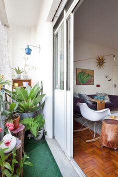 "Sneak Peek: Lella and Julio's São Paulo Apartment. ""This is my pride as a gardener. We planted everything here, every time we see a flower blossom, we take a moment to enjoy it."" #sneakpeek"