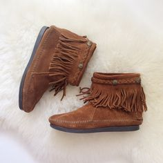 Minnetonka Moccasin Cognac Fringe Booties These comfy moccasin booties are perfect for this season! They feature zippers on back for easy on and off, braided trim with fringe, and suede construction throughout. Worn once and in excellent condition. No trades please. Minnetonka Shoes Ankle Boots & Booties