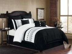 Duck River Textile Wembrioderedley Diamond Embriodered 8-Piece Queen Oversize and Overfilled Comforter Set, White/Black by Duck River Textile. $97.33. Heavy embroidery. Oversized/ overfilled. 100% Polyester. Soft brushed fiber. Wembley 8-piece comforter set is the most exquisite comforter ensemble available today. This magnificent set is highlighted by its fading embroidered mosaic and only comes in black and white. This comforter is made of our finest soft brushed fiber...