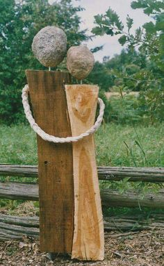 Rough hewn wood, stones and cord make this Beautiful sculpture!