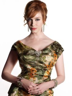 Christina Hendricks as Joan Harris on Mad Men. Her jewels are wow and also the dress...