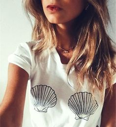 Sea Shell Bra T-Shirt | Sea Shell Boobs Shirt **POPULAR TEE- PURCHASE WHILE IN STOCK. Boyfriend Tee Unisex Sizing: Women may prefer to order a size down. - 100% Combed & Ring-Spun Cotton - Soft baby k