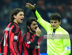 AC Milan's Sweden forward Zlatan (L) and midfielder Gennaro Gattuso (C) argue with referee Antonio Damato (R) during their Italian serie A football match against AS Roma at the San Siro stadium in Milan on December 18, 2010. AS Roma won 1-0.