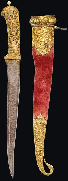 Indian (Kutch) pesh kabz dagger, 19th century, single-edged blade of typical shape, the hilt carved with rosettes and inset with gems, the sheath with fine mounts carved with floral scrolls with bird-shaped finial 15¼in. (38.6cm.).