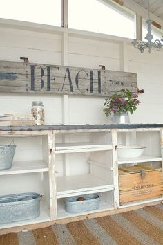 "A ""Beach"" sigh written on reclaimed wood. A cheap and easy way to recycle old materials and make something homey and new."