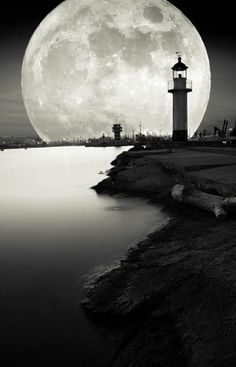 Silhouette of a #lighthouse against the backdrop of a full #moon http://lclemens.tumblr.com/post/3466778411