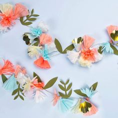 Create a splash of color and style for your summer party with this beautiful floral garland with crepe paper tassel, cone and paper leaf pennants