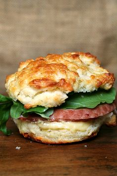 Ham & arugula on homemade cheddar biscuits with mustard sauce