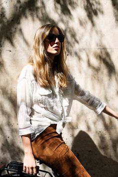 suede skirt and shadows! Love the mix of fabrics in this look the of course the off-centre parting.