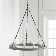 """Shop Geoffrey 36"""" Round Wood Chandelier.  A ring of grey-finished mango wood hangs down from a weathered iron chain to cast a rustic, industrial glow over a dining table or kitchen island."""