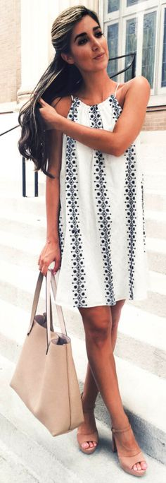 Jessi + patterned white dress + summer necessity + Simple yet effective + patterned detail + adds a different dimension + statement bag + matching heels + ultra-cute.   Dress/Shoes/Bag: Nordstrom