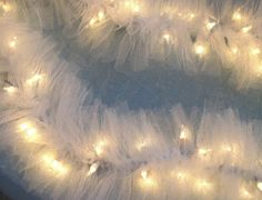 Wedding Lighted Swag Garland White TULLE on STRING LIGHTS, wedding or home, electric lights can be plugged into two more strands Tulle Lights, Fairy Lights, String Lights, Light String, White Christmas, Christmas Lights, Christmas Holidays, Christmas Ornament, Woodland Christmas