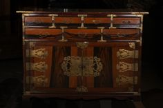 Directly from Korea, this chest is a 20th century piece, having mixed woods and decorated metal hinges.