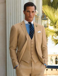 A beige three-piece suit with some blue and white to it. Model: Ollie Edwards.
