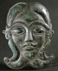 Mask of a man with beard. Bronze ornament from a Celtic wooden pitcher. Second half 5th BCE. Height 8 cm.
