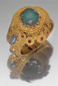 BRACCIALE IN ORO, SMERALDO, RUBINI, ZAFFIRI E DIAMANTI 1890 CIRCA GOLD, EMERALD, RUBY, SAPPHIRE AND DIAMOND BRACELET, 1890S | Found on Sothebys